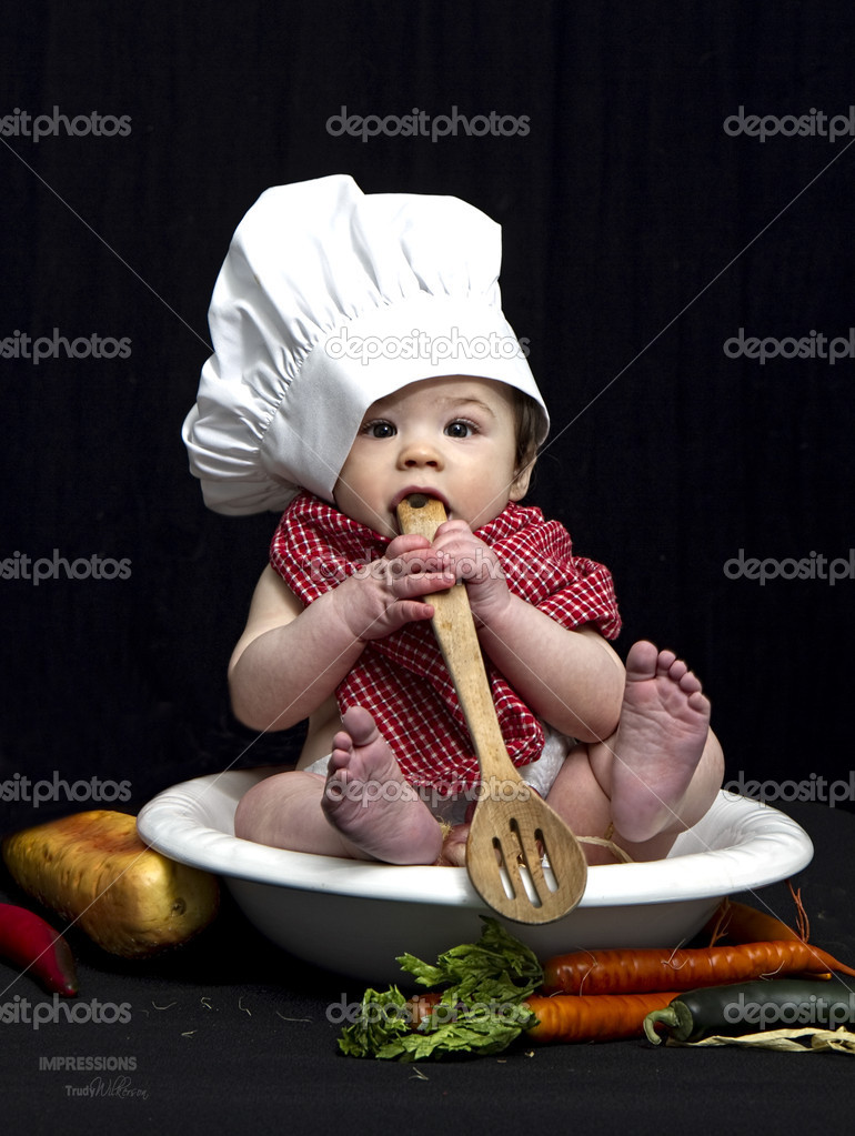 84d5aa87d Small baby in bowl wearing chef's hat — Stock Photo · Cute baby with wooden  spoon in its mouth while sitting in large bowl.
