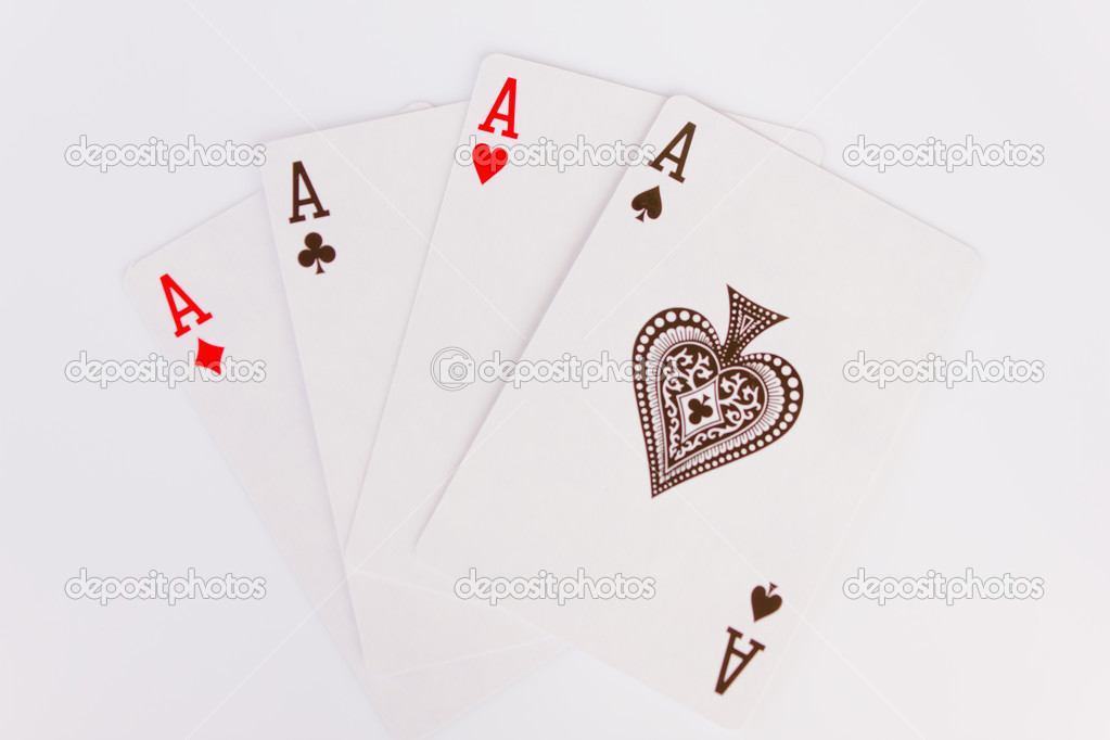 Playing cards showing four aces with one blank card