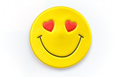 Bright, yellow sticker with a smiley face