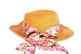 Fotografie a straw hat with a ribbon
