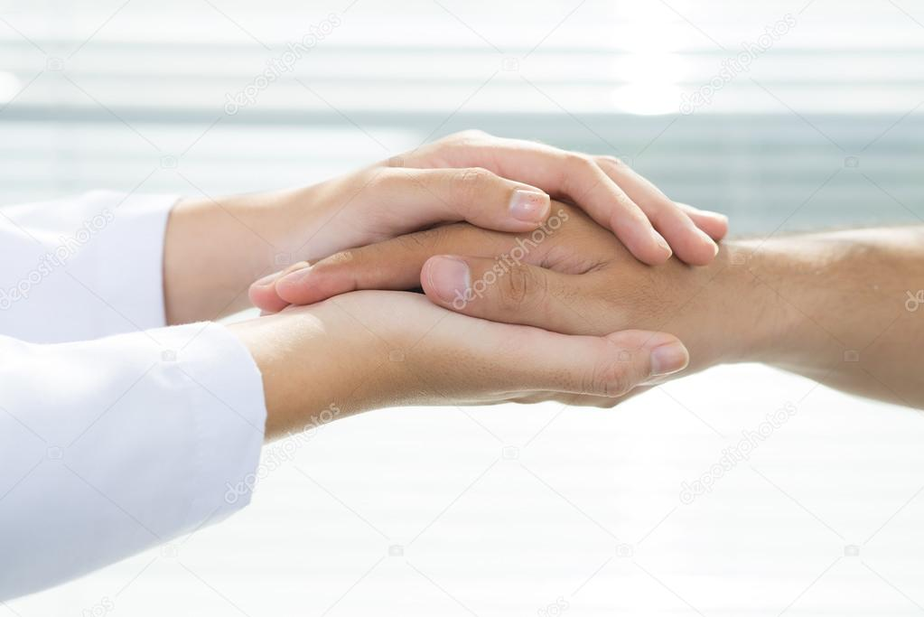 Two holding hands