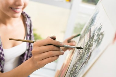 Cropped image of an artist drawing a picture on the foreground stock vector