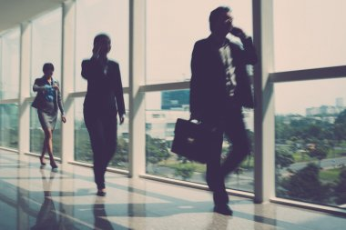 Blurry image of businesspeople