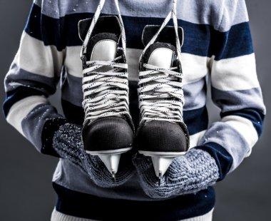 Man with hockey skates