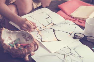 Human hand sketching dress