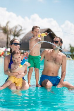 Parents and children enjoying in pool