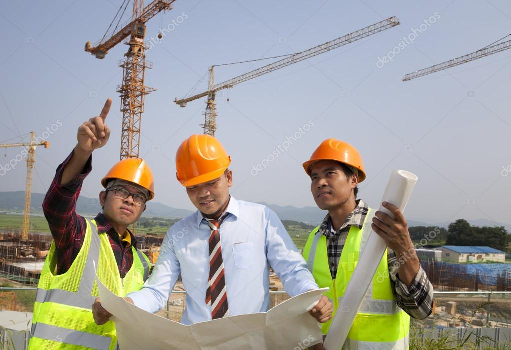 architect and construction workers discussion on site — stock