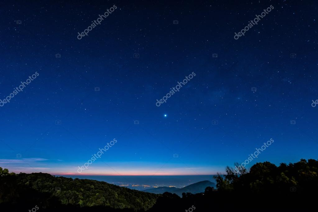 Star in blue sky night time scene