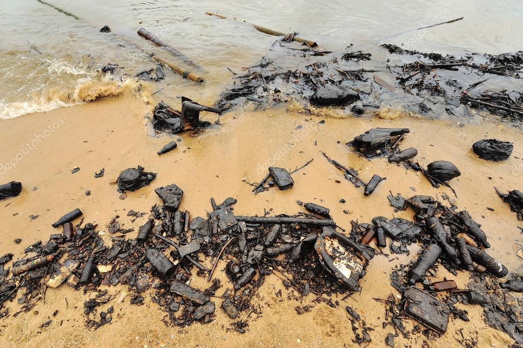 Oil spill. Contaminated Beach.