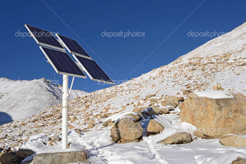 solarcells on a winter with snow mountain in Ladakh, India
