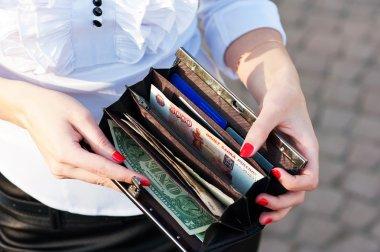 Woman shows purse