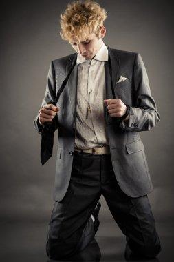 Businessman is kneeling in depression