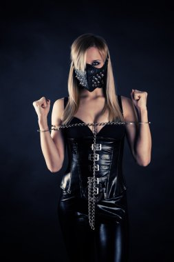 Slave in a mask with spikes