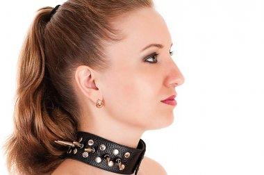 Woman face profile with spiked collar