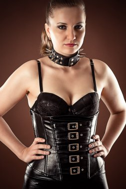 Woman in corset and spiked collar