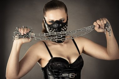 Woman in a mask with a chain