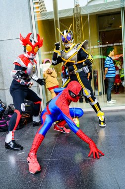Cosplayer as characters Kamen Rider and Spide man.