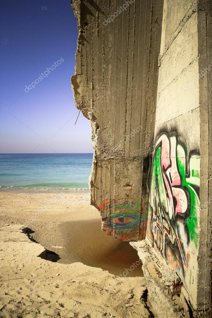 Graffiti on the wall by the sea