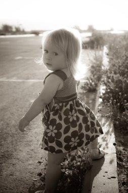 Little girl near the road