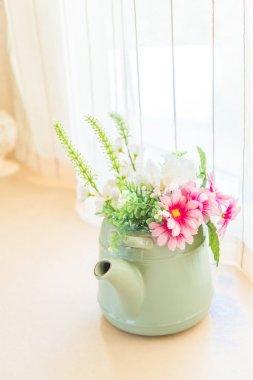 Vintage tone artificial flower on pot - home interior