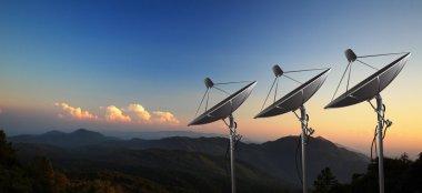 Satellite dish with sunset