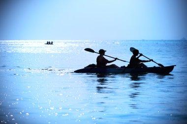 two female kayaking