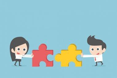 Business teamwork with jigsaw