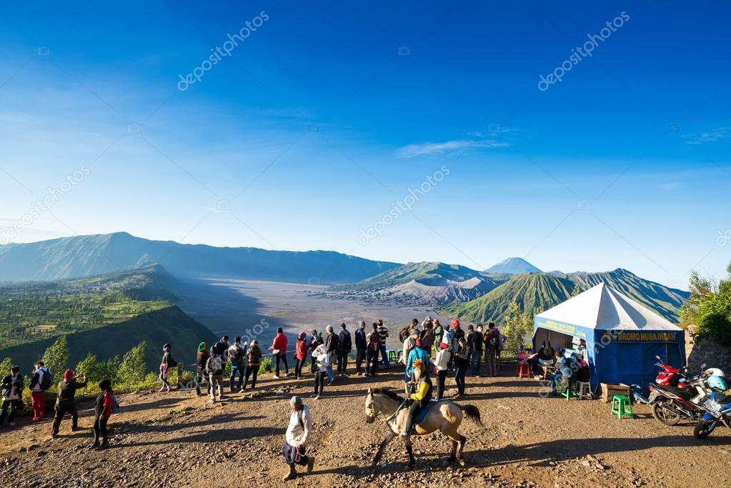Tourists hiking and ride the horse to viewpoint on Mount Penanjakan