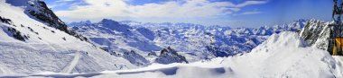 Panorama of Snow Mountain Range Landscape with Blue Sky from 3 Valleys in french Alps