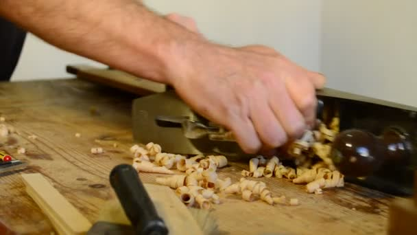 Carpenter working with wood planer.