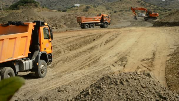 Trucks and excavator working in public works