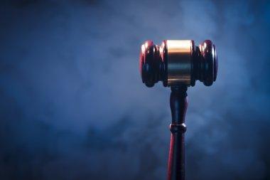 judge gavel on blue background