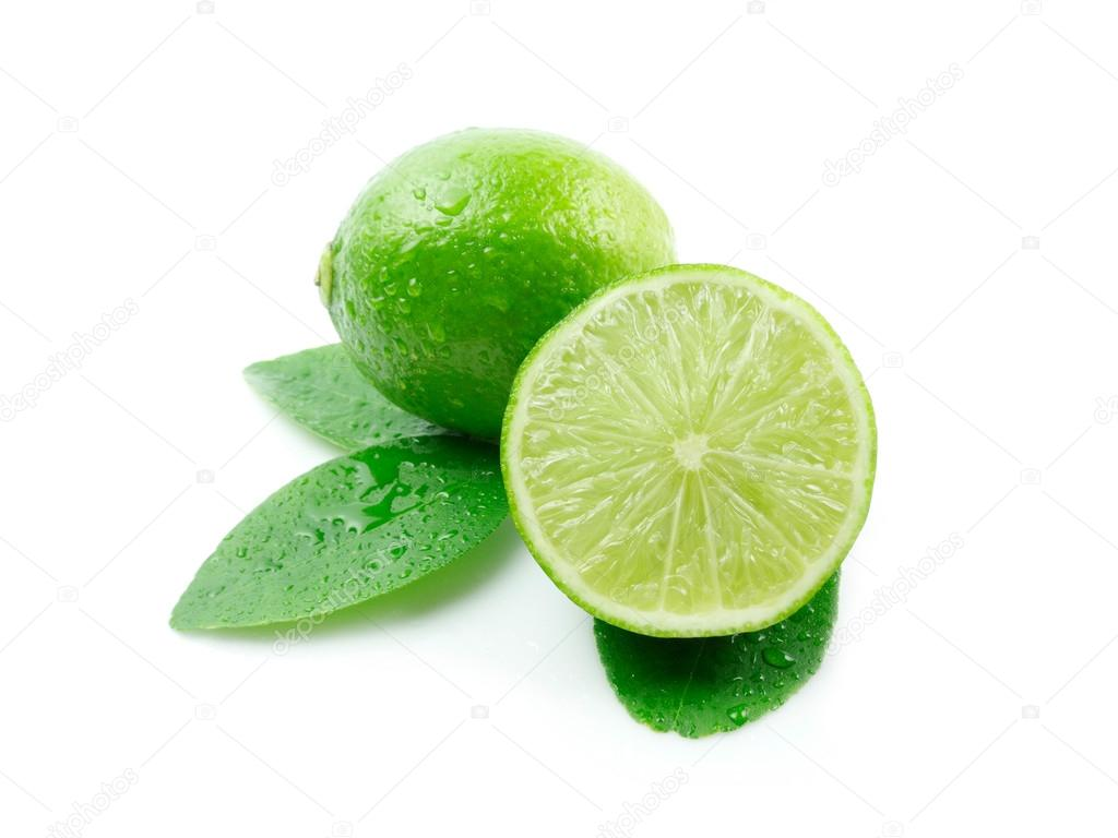 Lime with leaves on white background