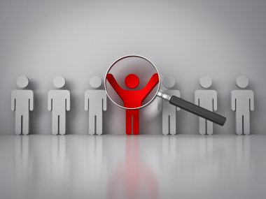 Searching for the right person concept , Magnifying glass focusing on the red man standing with arms wide open on white wall