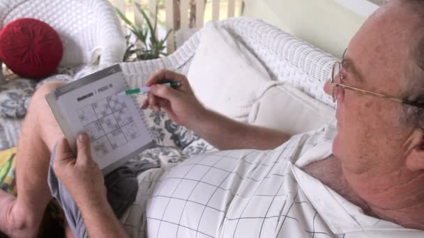 Man Playing Sudoku Tilt