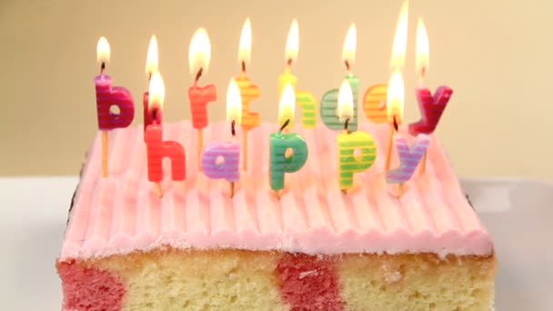 Lighting separate birthday candles on a cake