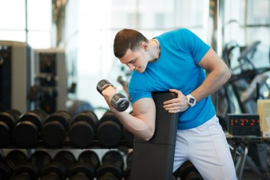 man doing exercises dumbbells