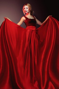 Woman in elegant red dress