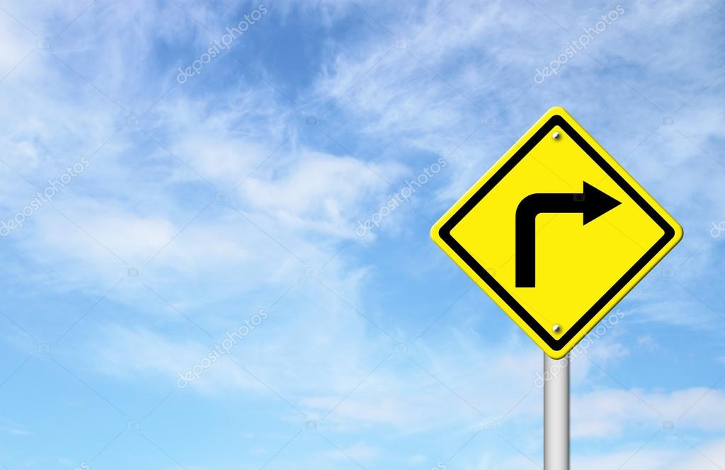 Road Sign - Right Turn Warning with blue sky