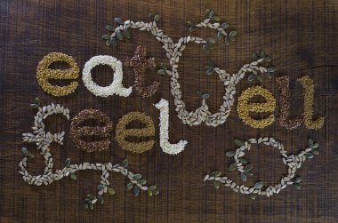 The Phrase Eat Well, Be Well Written And Decorated In Seeds