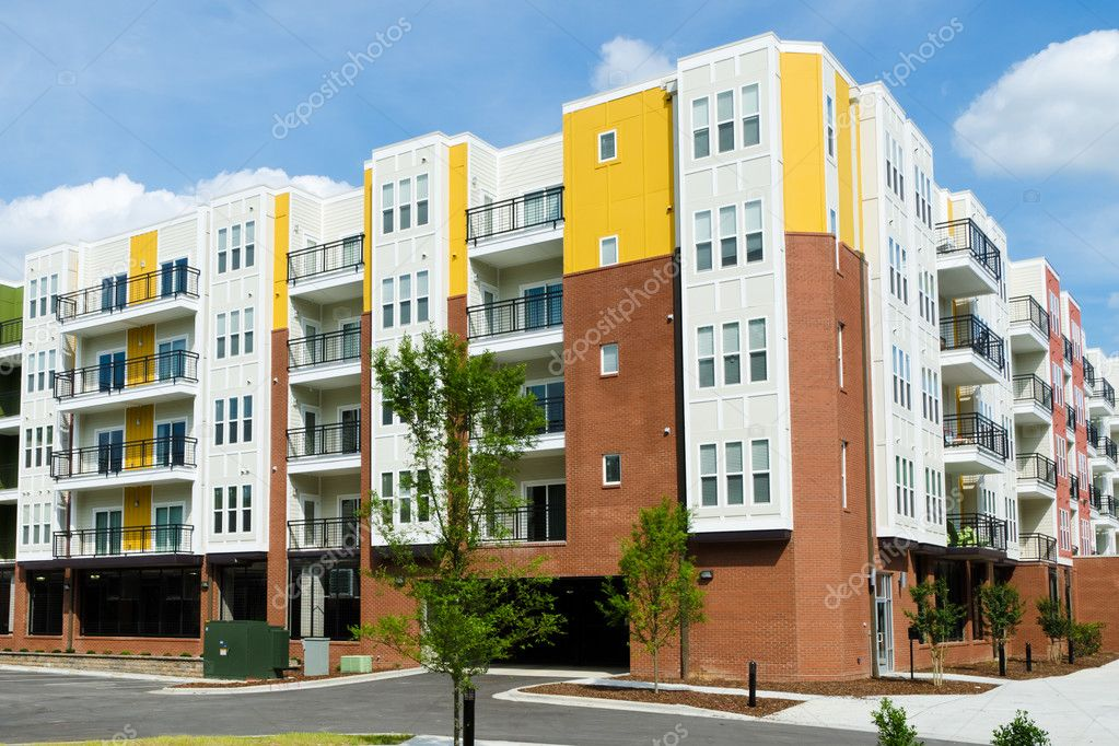 Modern apartment building with parking garage stock for Image immeuble moderne