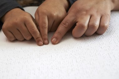 Teaching blind kid to read text in braille language