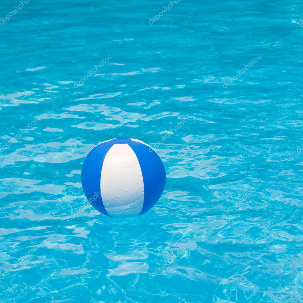 Pool Water With Beach Ball white and blue beach ball floating on a sparkling blue swimming