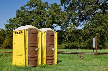 Yellow portable toilets