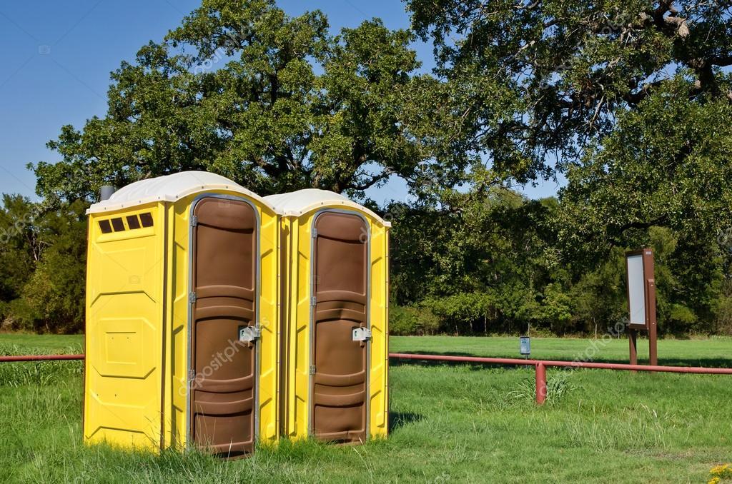 Yellow portable toilets