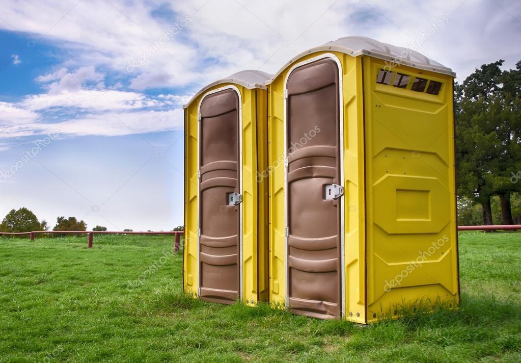 Two yellow portable toilets