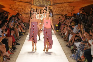 MIAMI - JULY 20: Designers Catalina Álvarez and Mariana Hinestroza walks runway with models at the Agua Bendita Collection for Spring Summer 2013 during Mercedes-Benz Swim Fashion Week on July 20, 201