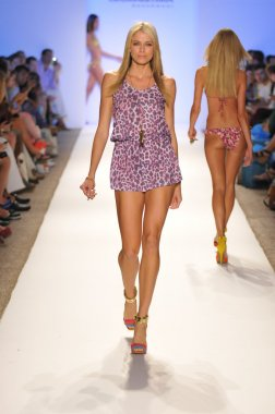 MIAMI - JULY 20: Model walks runway at the Cia Maritima Collection for Spring Summer 2013 during Mercedes-Benz Swim Fashion Week on July 20, 2012 in Miami, FL