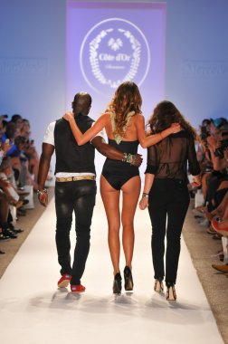 MIAMI - JULY 23: Designers and Model walks runway at the Cote Dor Swimwear Collection for Spring Summer 2013 during Mercedes-Benz Swim Fashion Week on July 23, 201
