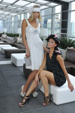 Two models wearing couture designer gowns